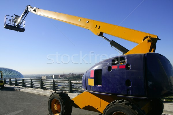 Car little hydraulic crane in blue and yellow colors Stock photo © lunamarina