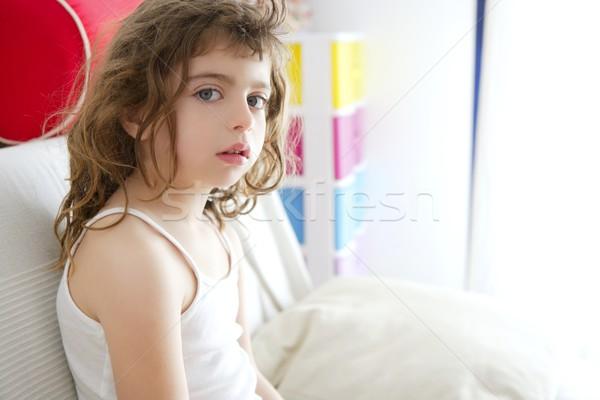 little burnette girl sin on sofa window light Stock photo © lunamarina