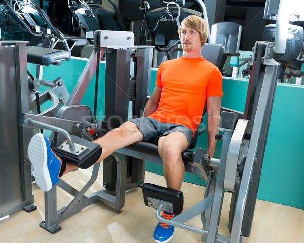 Gym man leg extension cuadriceps exercise Stock photo © lunamarina