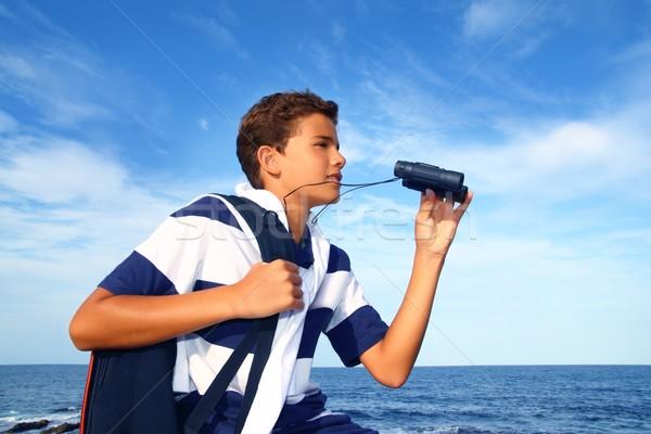 Erkek genç dürbün kâşif mavi plaj Stok fotoğraf © lunamarina