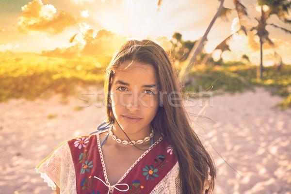Latin beautiful girl happy in beach sunset Stock photo © lunamarina