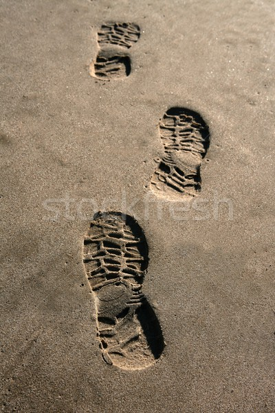 Lábnyom cipő tengerpart barna homok textúra Stock fotó © lunamarina