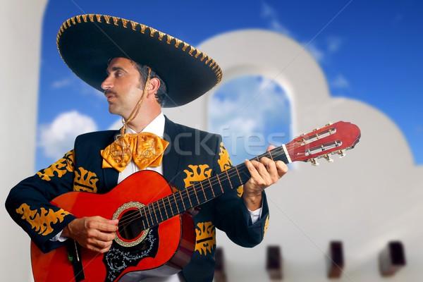Charro Mariachi playing guitar Mexico houses Stock photo © lunamarina