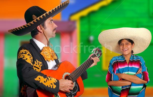Mexican mariachi charro man and poncho Mexico girl Stock photo © lunamarina