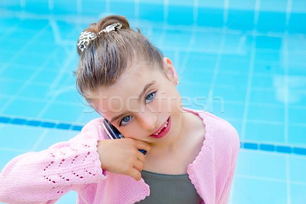 child little indented girl talking mobile phone Stock photo © lunamarina