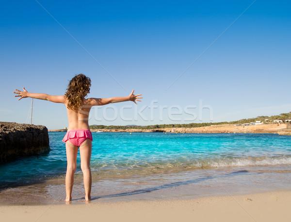 Ibiza Cala Conta beach open arms little girl Stock photo © lunamarina