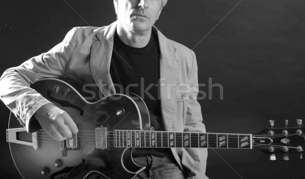 Jazz guitar player playing instrument Stock photo © lunamarina
