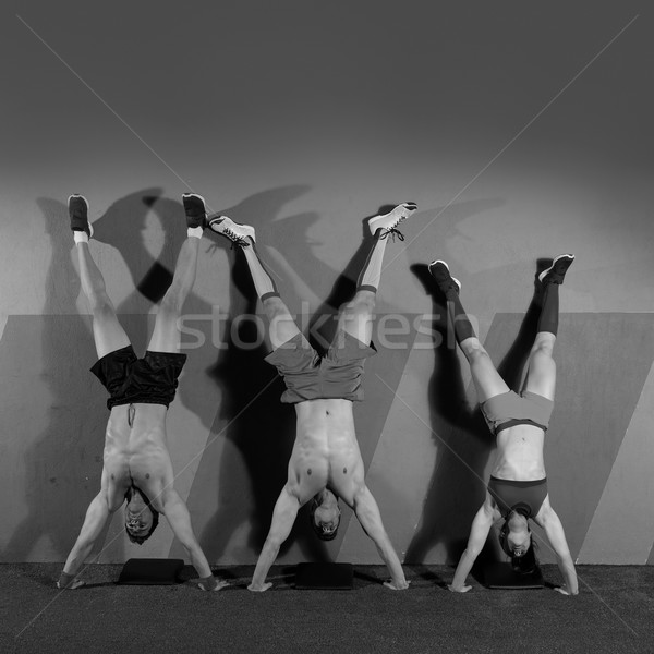 Handstand push-up group workout at gym Stock photo © lunamarina