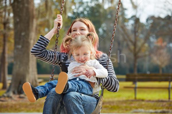 Сток-фото: матери · дочь · Swing · парка · площадка