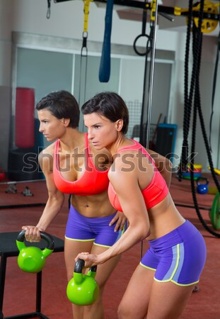 Crossfit fitness woman standing at gym holding trx Stock photo © lunamarina
