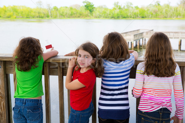 Children girls back looking at lake on railing Stock photo © lunamarina