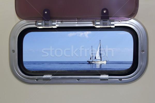 Boat porthole sailboat view blue ocean sea Stock photo © lunamarina