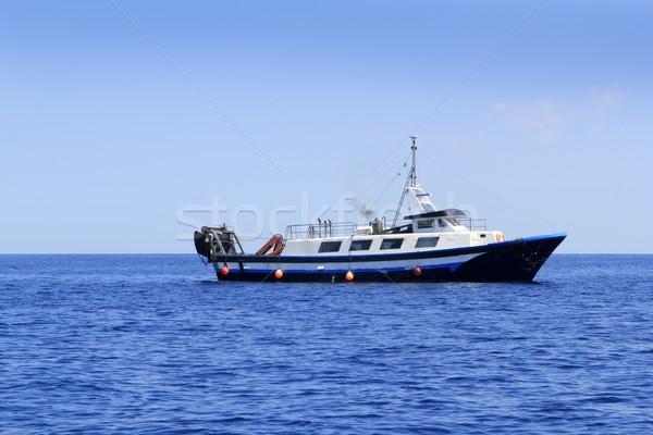 trawler boat working in mediterranean offshore Stock photo © lunamarina