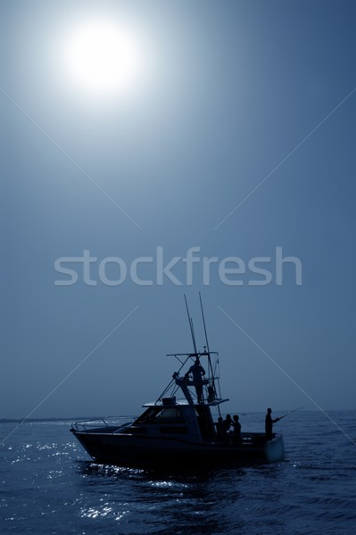 Backlight on blue water sport fishing boat Stock photo © lunamarina