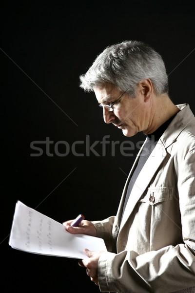 businessman reading at work, senior gray hair Stock photo © lunamarina
