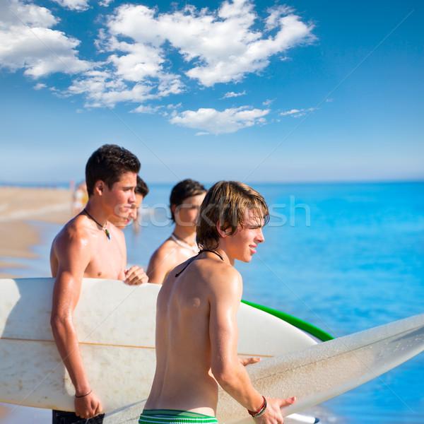 Sörfçü genç erkek konuşma plaj kıyı Stok fotoğraf © lunamarina
