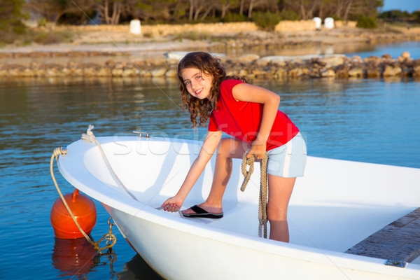 Kid girl pretending to be sailor in boat bow at Formentera Stock photo © lunamarina