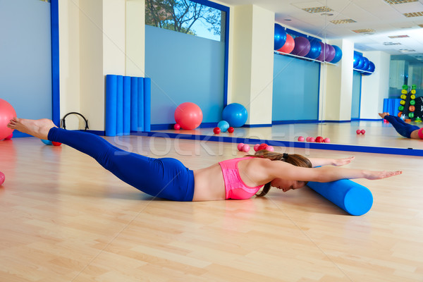 Pilates woman roller swan dive roll exercise Stock photo © lunamarina