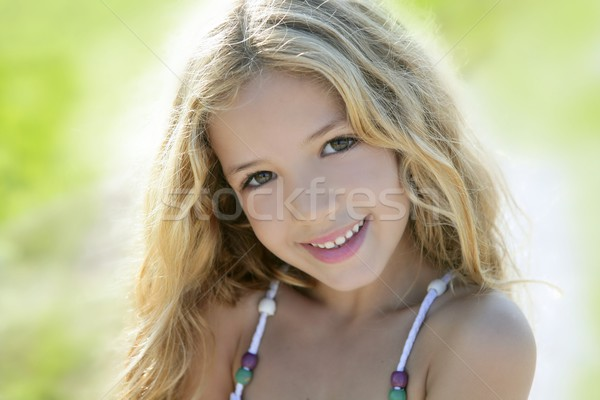 Happy smiling girl portrait green outdoor Stock photo © lunamarina