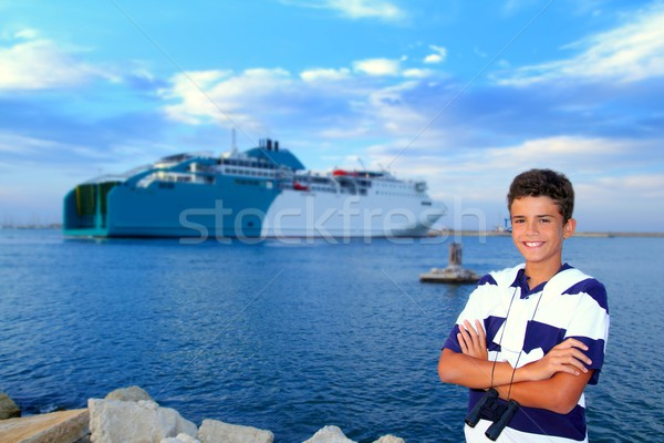 Stock photo: boy teenager in ferry harbor blue sea
