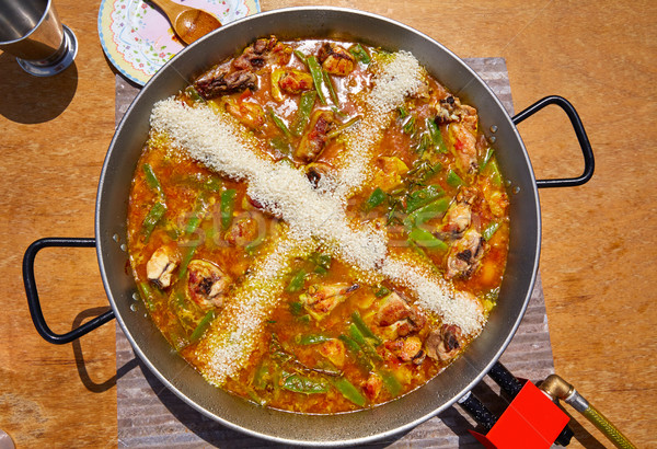 Paella from Spain recipe process ad the rice Stock photo © lunamarina