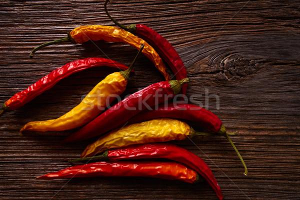dried hot chili peppers on aged wood Stock photo © lunamarina
