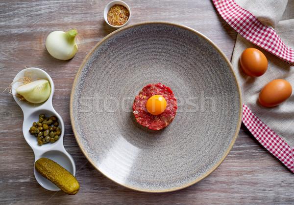 Steak Tartare raw meat recipe with egg yolk Stock photo © lunamarina