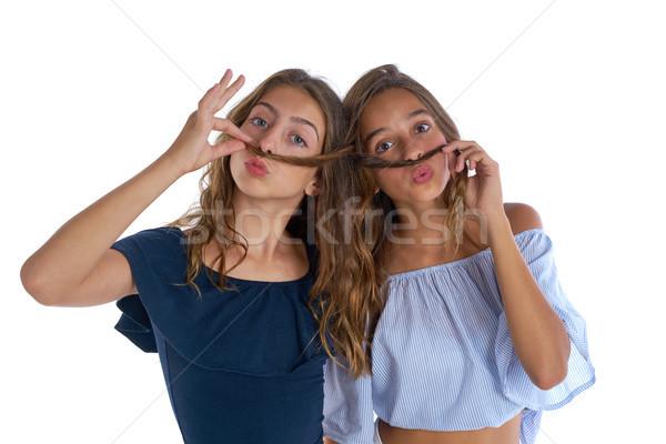 Teen best friends girls fun hair moustache Stock photo © lunamarina