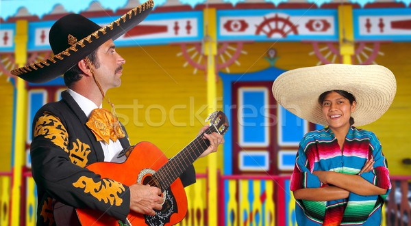 Mexican mariachi charro man and poncho Mexico girl Stock photo © lunamarina