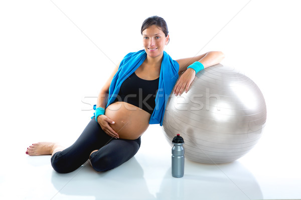 Beautiful pregnant woman at fitness gym relaxed  Stock photo © lunamarina