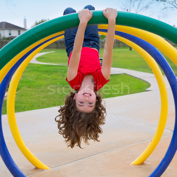 children kid girl upside down on a park ring Stock photo © lunamarina