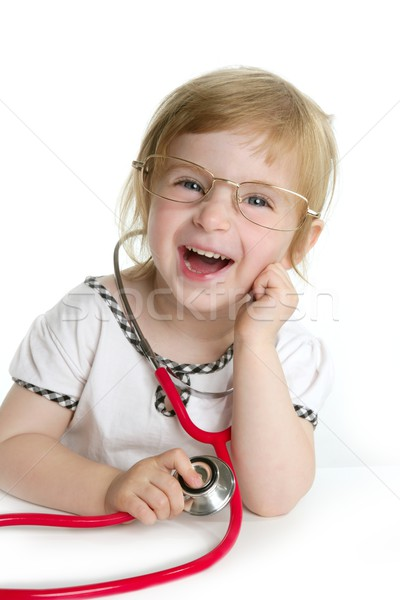 Cute little girl pretending to be a doctor Stock photo © lunamarina