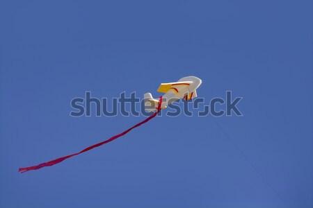 Airplane kite flying on blue sunny sky Stock photo © lunamarina