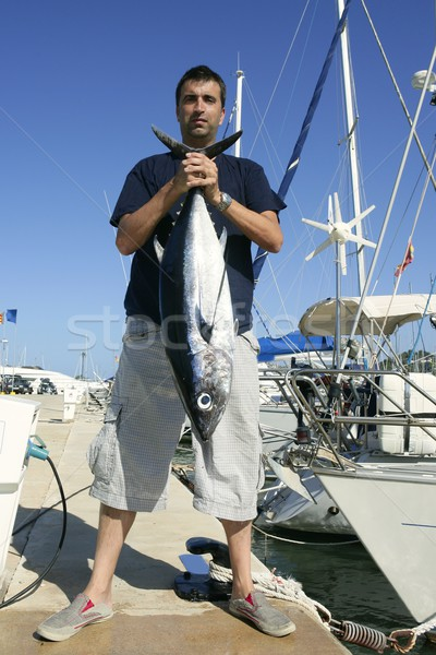 Angler fishing big game Albacore tuna on Mediterranean Stock photo © lunamarina