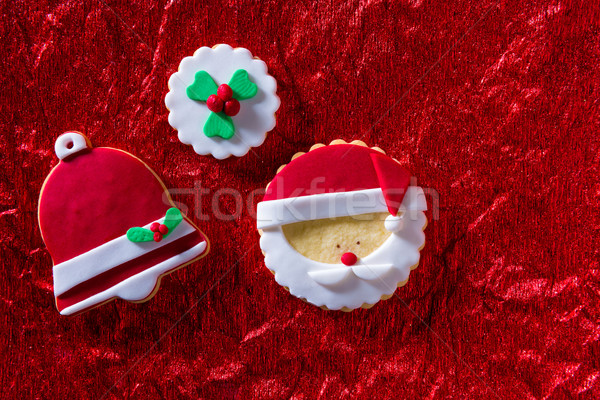 Christmas cookies Santa face and Xmas bell on red background Stock photo © lunamarina