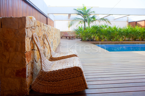 Stock photo: Teak wood house outdoor with swing chairs and pool