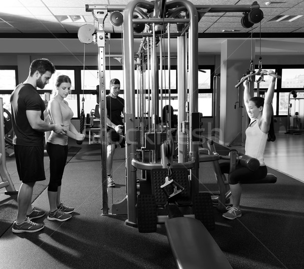 cable pulley system gym workout fitness people Stock photo © lunamarina