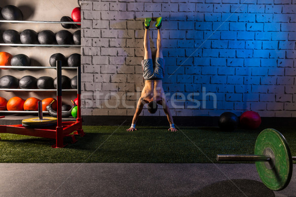 Handstand push-up man workout at gym Stock photo © lunamarina