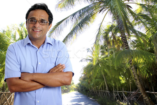 Indian latin tourist man in tropical palm tree caribbean Stock photo © lunamarina