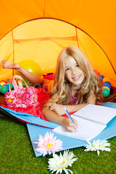 Children girl writing notebook in camping tent with flowers Stock photo © lunamarina