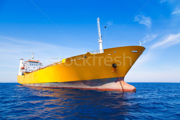 Anchor cargo yellow boat in blue sea Stock photo © lunamarina