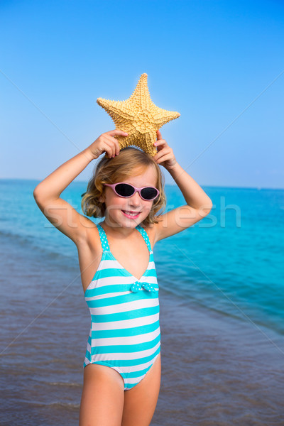 child kid girl in summer beach vacations with starfish Stock photo © lunamarina