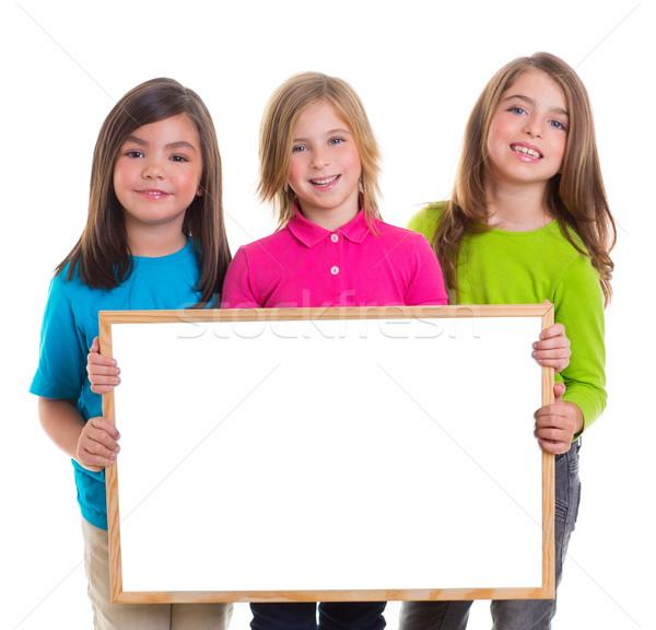 Gyerekek lányok csoport tart fehér tábla copy space Stock fotó © lunamarina