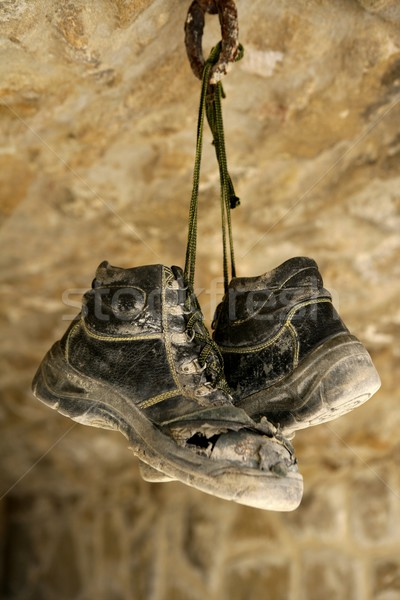 Construction worker left his aged old boots away Stock photo © lunamarina