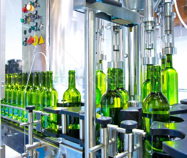 white wine in bottling machine at winery Stock photo © lunamarina