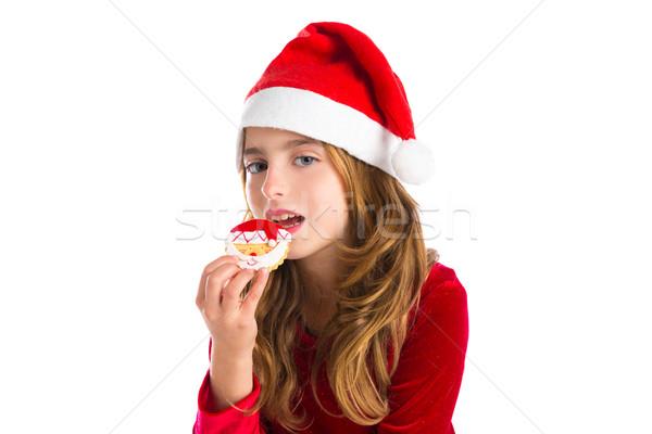 Christmas kid girl eating Xmas Santa cookie Stock photo © lunamarina