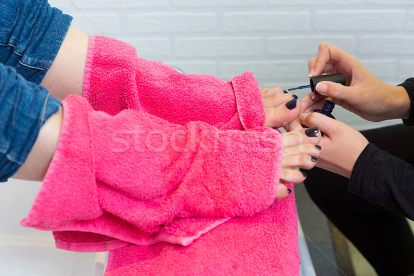 Pedicure chair spa and woman hands painting toes nail polish Stock photo © lunamarina