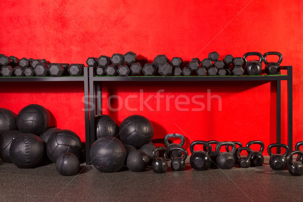 Kettlebell  dumbbell and weighted balls at gym Stock photo © lunamarina