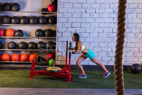 sled push woman pushing weights workout Stock photo © lunamarina