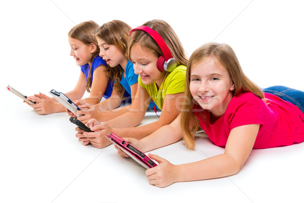 sisters kid girls tech tablets and smatphones Stock photo © lunamarina